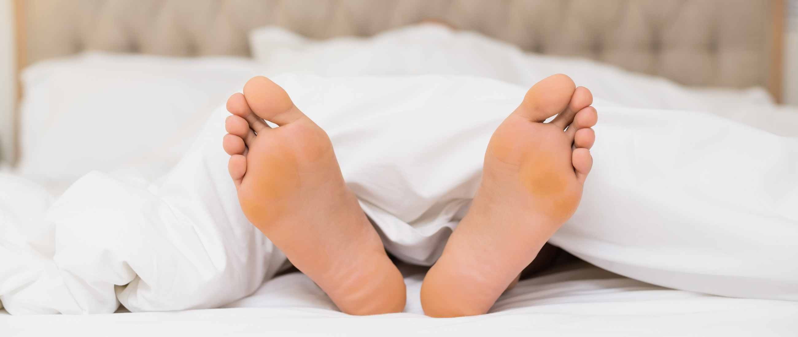 Feet In Bed Shutterstock Main Image